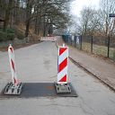Falkensteiner Ufer, barrier, traffic sign, place-name sign, fence, gastronomy
